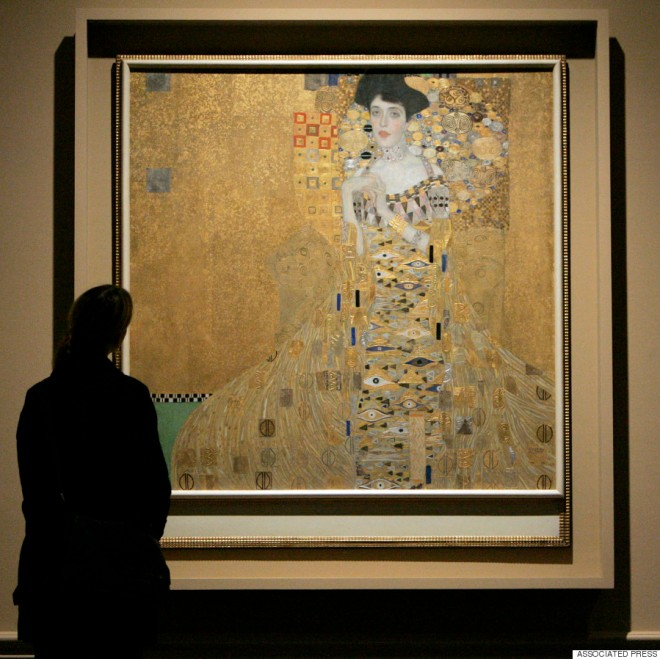 "A visitor at the Los Angeles County Museum of Art views the painting titled ""Adele Bloch-Bauer I,"" April 4, 2006, in Los Angeles. (AP Photo/Ric Francis)"