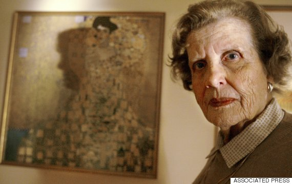 "Maria Altmann, at her home in Los Angeles on Jan. 9, 2004, stands before a poor reproduction of famed Austrian painter Gustav Klimt's ""The Portrait of Adele Bloch Bauer I."" (AP Photo/Nam Huh)"