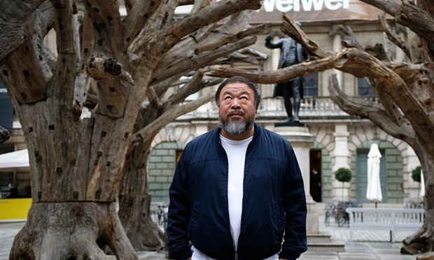 Ai Weiwei stands with his sculpture 'Tree' as he previews works from His landmark art exhibition at the Royal Academy. Photograph: Alex B. Huckle/Getty Images